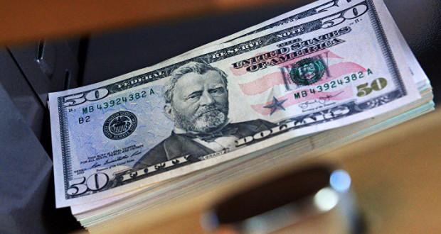 Доллар дорожает к мировым валютам на позитивной статистике по продажам новых домов в США